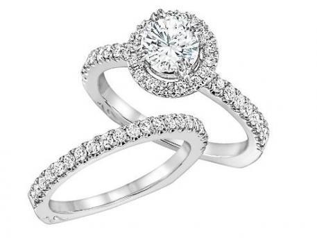 Niki J - This diamond halo engagement set contains round brilliant cut diamonds prong set around the center diamond and down the shank. The set can be cast in 14k or 18k white or yellow gold and can hold from a .50ct to 2ct diamond in the center. Call For Price
